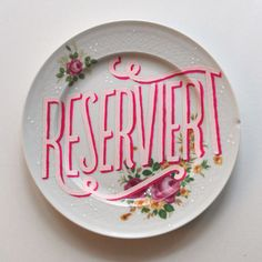 """Berlin-based designer Georgia Hill created these gorgeous hand-lettered plates as aunique """"Reserved"""" sign for the tables atThe Michelberger Restaurant."""