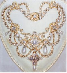 Queen Aelxandras Dagmar Necklace - In 1863 King Frederick VII of Denmark had the crown jeweler in Copenhagen design this necklace in the Byzantine style as a wedding gift for his daughter, Princess Alexandra, later Queen Alexandra of England. It had 118 pearls and 2,000 diamonds. Hanging on a gold loop from the center piece is a cloisonne enamel facsimile of the 11th centry gold Dagmar Cross.