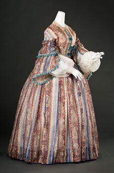 Day Gown  Europe or United States, c. 1857  Printed twill-striped silk gauze, silk fringe & silk ribbon