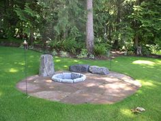 rock seats, fire pit and dry patio area
