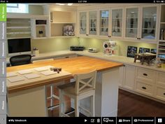 Craft room idea.  Will have a similar work table with a bank of draws down the right hand side of seating spot.