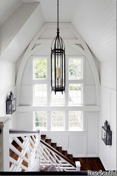 The staircase – here you can see the Pennsylvania Dutch influence  -  which resembles a renovated barn.   The woodwork and railing are just amazing.  Love the lanterns on the walls