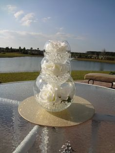 I like this centerpiece idea...you could have each level be slightly different--pearls/rhinestones, flowers, candles, etc. DIY Wedding Centerpieces   DIY Wedding Decorations - wedding centerpieces and ideas