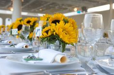 Sunflowers for Wedding Tables | Stella and Moscha - Exclusive Greek Island Weddings | Photo Ippokratis Alexiou