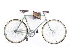 """Oak Wood Bike Hanger """"Iceberg"""" by Woodstick Ltd.. $644.90, via Etsy."""