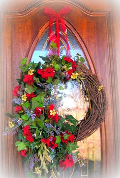 "Gorgeous wreath!!  It measures 30"" height not counting the ribbon, and 22"" across....Full of Geraniums , Greenery and Filler Flowers.....$49.99  http://www.primitivehomedecorandmore.com/floral-wreaths.html"