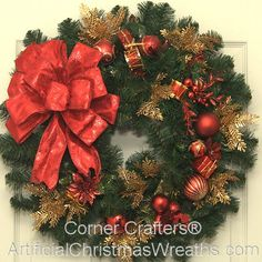 Merry Christmas Wreath - 2013 - Our Merry Christmas Wreath has colorful red and gold decorations beautifully arranged on our deluxe fir wreath and finished with a lovely red bow. - #ChristmasWreaths #Wreath #Wreaths #ArtificialChristmasWreaths #Christmas #MerryChristmas
