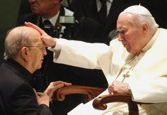 FILE - In this Nov. 30, 2004 file photo, Pope John Paul II gives his blessing to father Marcial Maciel, founder of the Legion of Christ, during a special audience at the Vatican. Pope Benedict XVI took over the Legion in 2010 after a Vatican investigation determined that Maciel had sexually molested seminarians and fathered three children by two women. Following a decision Thursday Feb. 14, 2013, by the Rhode Island Supreme Court, documents are set to be unsealed related to a lawsuit contesting