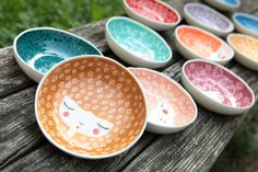 Handmade ceramic bowls by Marinski Handmades. Illustrations are protected with trasparent glossy glaze. They measure 15 cm in diameter and 3 cm in height. Available colors: peach blush, bright apricot, honey, dragon red, mandarin orange, dark red, purple, yellow, teal, green nil and blue. FOOD SAFE, MICROWAVE SAFE