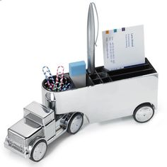 You won't see one of these on many desks - a shiny, chrome-plated mobile semi-truck paperweight. And it is useful for holding those pesky desk things like pens, pencil sharpeners, post-it notes, and it has a magnetic holder for paperclips.