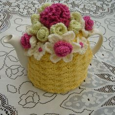 knitted flower basket tea cosy