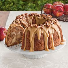 Apple-Cream Cheese Bundt Cake -     With a cream cheese filling and sweet praline frosting, this apple bundt cake is a must-try! Garnish with toasted pecans for a pretty finish and a little crunch.