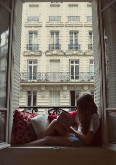 Reading on the window seat in Paris.