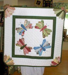 dresden butterfly--found @ http://quiltedescapes.blogspot.com/2010/05/dresden-butterfly.html