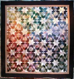 """""""Design Memories"""", 82.5 x 88"""",  by Bonnie Keller.  Tumbling block star design.Made with interior design fabrics; machine and hand quilted. 1994."""