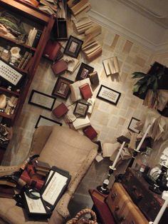 fun library with book pages on the walls ~LaurenCFarkas Interior Design Inspiration Board~