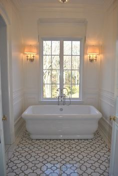 #CheviotProducts likes this bathroom with its lovely color, floor, tub and sconces.
