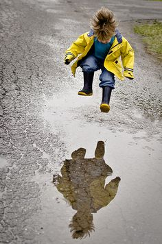 "LOVE the composition and LOVE that the girls reflection is included in this shot - makes me want to go jump in a puddle :)  Photo by Danielle Donders (Mothership Photography) - http://danigirl.ca/photo/. Second place for the ""yellow theme"" Iheartfaces photography competition."