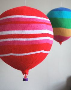 knit hot air balloons for classroom, above tables