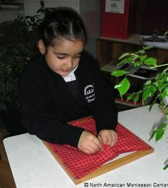 Montessori Classroom Practical Life Activities: The Montessori Dressing Frame. Learn more about these unique activities and how they help foster confidence and independence.