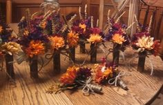 These were the boutonnieres for my guys! A few of my bridesmaids and I made em!!! My husband and I hunt so I thought the shotgun shells wear perfect added a little of who we are without going overboard.