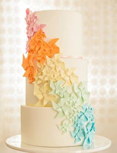 Colorful Cascading Pinwheels Tiered Cake