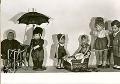 photo of kathe kruse dolls with that oh so hard to find umbrella!