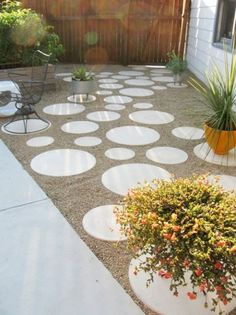 Polka dot sidewalk?  How have I not seen this before.  Circle pavers + fill.  Awesome.  Just think of the different games you could play.  Just think of how fantastic it would be to have a POLKA DOT SIDEWALK. Could make trails with this in the back yard!!