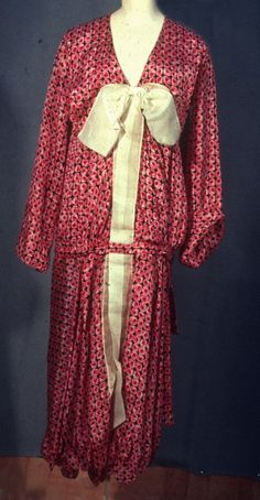 1927 Black and Pink Print Silk and Cream Organdy drop waist long sleeve dress with organdy bow at CF neck, long streamers caught under self belt. Scalloped hemline. Very fluttery. Via Fine Arts Museums of San Francisco.