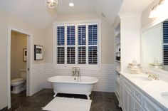 Claw tub adds country charm to this bath.  Country House Plan # 101195.