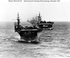 Task Group 38.3 enters Ulithi anchorage in column formation on December 18,1944. The ships were returning from strikes on targets in the Philippines.    From front to back:  USS Langley (CVL-27) a small aircraft carrier.  USS Ticonderoga (CV-14) aircraft carrier  USS Washington (BB-56) battleship  USS North Carolina (BB-55) battleship  USS South Dakota (BB-57) battleship  USS Santa Fe (CL-60) light cruiser  USS Biloxi (CL-80) light cruiser  USS Mobile (CL-63) light cruiser  USS Oakland (CL-95) l