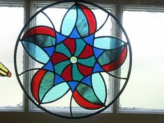 Geometric stained glass disc by Tilly Veedub 25, via Flickr