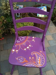 I like these painted chairs. Redo old chairs with a fabulous bright color and a fun print design on the seat.....great for outside on the patio