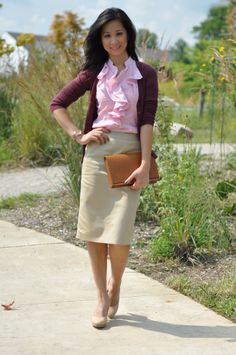 Pencil skirt, ruffled blouse and a cardigan. Staple items.