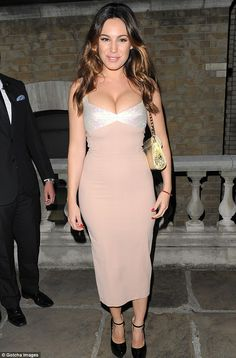 Keeping abreast of things: Kelly Brook, pictured at the Giles Deacon show at London Fashion Week on Monday night, shows off her assets in a tight pink dress