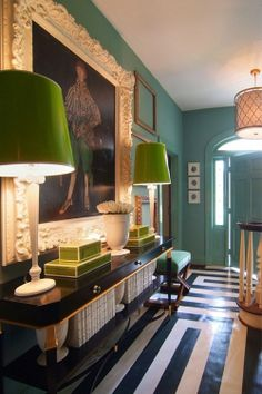 black and white floor + green lamps + teal walls