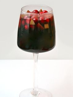 Mulled Wine Sangria: Give sangria a holiday twist by making a mulled wine studded with red and green fruit. #Christmas #Cocktails