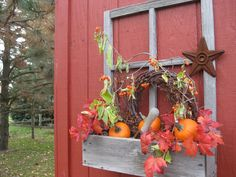 fall themed décor for a window box on the potting shed
