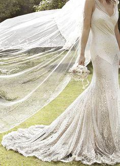 Kate Moss' wedding dress by designer John Galliano by Mario Testino for Vogue US September 2011