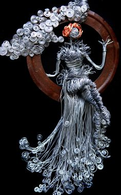 Swinging in the clouds by ~irishcompass  I just like this ,because it is so different. Tiny red, or metal flake seed beads in the curls of the dress might set off the ring.