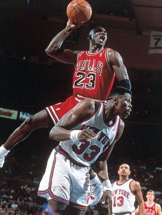 Michael Jordan dunks over Patrick Ewing