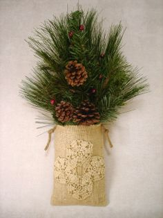 Rustic goodness  from the Feathered Nest - Burlap, lace and evergreens.