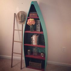 Rustic Rowboat Bookshelf in turquoise and red, distressed, canoe, cabin decor, nautical decor on Etsy, $200.00