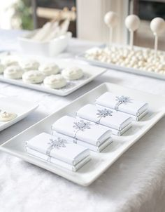 An all-white candy buffet will evoke memories of the first snowfall of the season and look effortlessly chic.