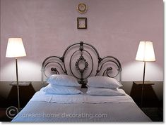 Non-girly pink bedroom color scheme - love the wrought-iron headboard, too.