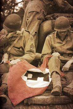 Rangers with captured Nazi flag - location unknown, probably 1943-44.