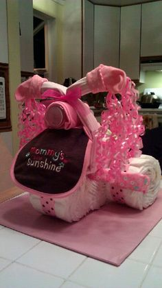 Pink Tricycle Diaper Cake: http://www.maidendshade.com/2012/01/tricycle-diaper-cake-tutorial.html