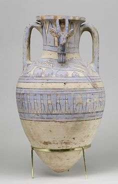 Blue-Painted Ibex Amphora from Malqata. Ca. 1390–1353 B.C.,  Egypt, Upper Egypt; Thebes, Malqata. This remarkable vase was found during the  excavations of the palace of Amenhotep III at Malqata in western Thebes. The head of the ibex had broken off, but was found nearby. Like much of the pottery at Malqata, this amphora was made of a red clay covered with a cream colored slip and decorated with blue, red, and black paint.