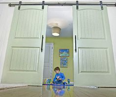 scratch the bar idea...what about a barn door on a track to open my room into the family room....
