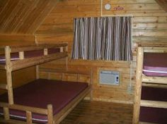 Hot Springs KOA - stay in one of our sleeping cabins that can sleep up to 5 people.  These cabins have a full size bed and 3 single size bunk beds.  There is AC, plus a ceiling fan, small desk, porch with porch swing, BBQ and picnic table.